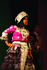 Sheng Yang models her Chinese Hmong clothing.