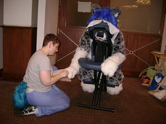 A fursuiter gets a massage