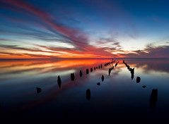 Untitled (Ev Lloyd) Tags: ocean old longexposure sunset sea seascape broken water clouds canon still jetty explore 14mm superaplus aplusphoto ostrellina dissued 5dmkii
