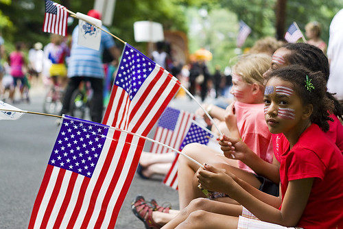 Nine-year-old Madeleine Allou of Silver Spring watches Takoma Parks 120th annual Independence Day parade pass by on Maple Avenue on July 4, 2009.