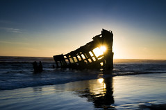 Sunset Shipwreck (frosteez) Tags: ocean blue sunset reflection silhouette coast nikon explore shipwreck wreck fortstevens peteriredale d300 iredale 175528 graveyardofthepacific