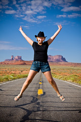 Alone on the road (jiquem) Tags: road blue red arizona woman usa green tourism nature hat yellow sunrise outside utah jump alone femme route valley chapeau navajo monumentvalley saut tourisme leverdesoleil dehors luminosity etatsunis luminosit tsbiindzisgaii inselbergs