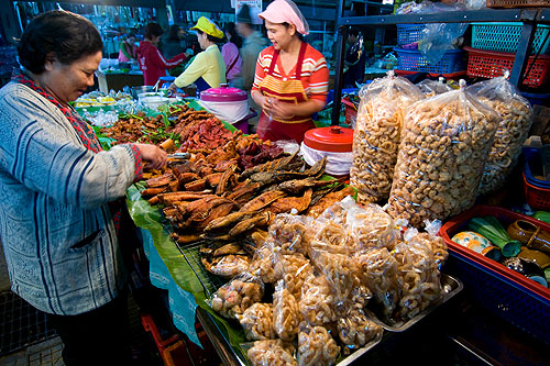 Choosing deep-fried meats to eat with nam phrik and sticky rice, Mae Hong Son's morning market