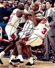 Dennis Rodman gets tackled by Michael Jordan and Scottie Pippen