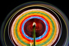 on a field trip at night (pbo31) Tags: california carnival red black color wheel northerncalifornia yellow night america dark circle lights oakland march movement lowlight nikon ride spin fast fair round spinning bayarea ferriswheel rides eastbay d200 shape funfair 2009 66th lightstream spinninglights coliseumindustrial