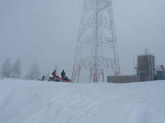 Snowmobile gathering at the tower