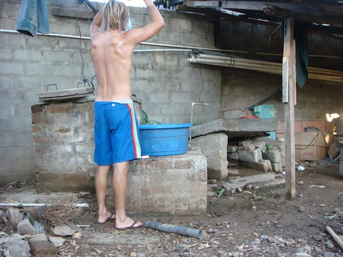 Bucket and scoop shower with water from the well in front of me. Somotillo, Nicaragua.