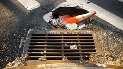 put a cone in it, pothole! (deana rae) Tags: brooklyn danger cone drain sinkhole