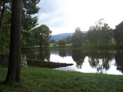 Wall entering pond (Stan4dSteph) Tags: sculpture art stormking andygoldsworthy stormkingartcenter