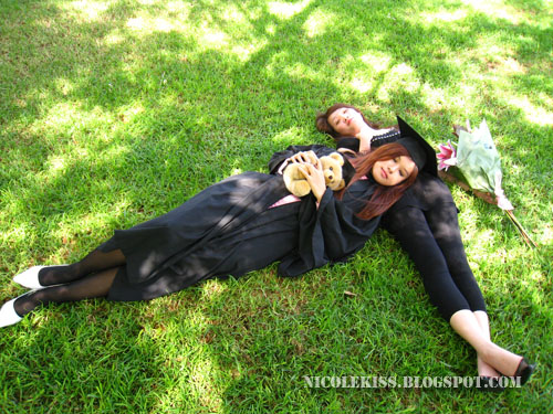 graduation photo_me and jessie sleeping on grass