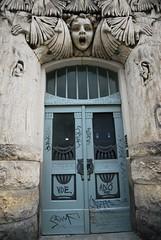 Scary Door (Axolot) Tags: door house art floral stone architecture graffiti dresden woodpecker sandstone faces fear haus carving lizard horror architektur specht gebude tr angst fassade jugendstil neustadt eidechse