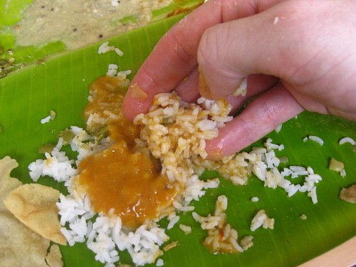 Eat the rice with your fingers.