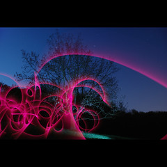 red light swirl (Paul Petruck) Tags: longexposure red sky tree colors night stars flash experiment swirl 1000views lightart strobes lightgames seenintheinterestingnessarchives