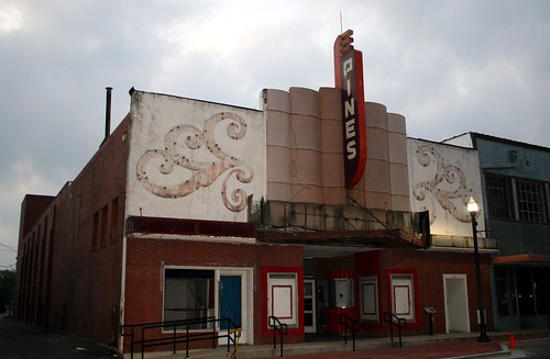 pines theater in morning on cloudy day