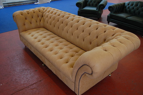 quilted leather couch. tan chesterfield sofa.