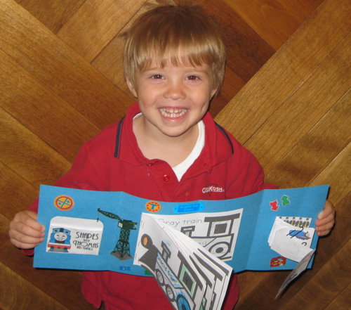 G'tums (age 3) with his Train Tot-book
