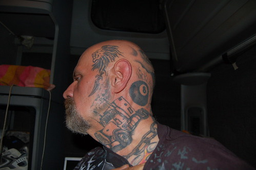 Left side of head, neck and face tattoo