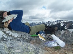 BC relaxing on the summit, gazing towards distant peaks.
