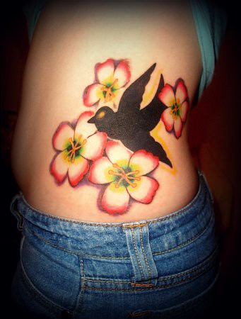 The tattoo is on my left side, and the flower by the tail of the dove goes
