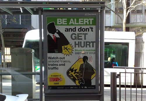 Tram shelter advertising rail safety