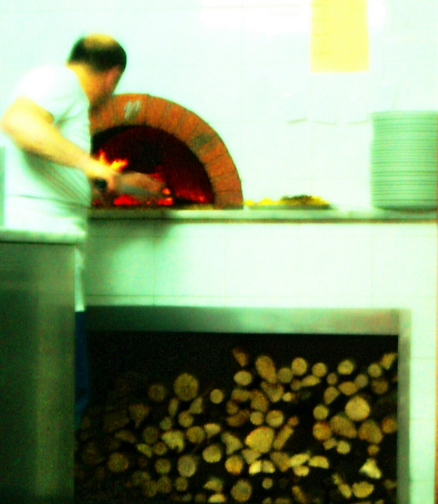 Making pizza traditional way - wood burning oven