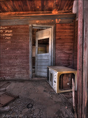 Nothing seems imminent (Dave Arnold Photo) Tags: pictures door usa newmexico abandoned window canon us photo oven image photos decay urbandecay arnold ruin picture pic images stove photograph damage nm ruraldecay cuervo trashed leftbehind davearnold guadalupecounty nmex darnold davearnoldphoto davearnoldphotocom