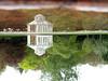 Toysize folly (Eva the Weaver) Tags: reflection green grass rain göteborg sweden gothenburg link turned botanicalgardens folly association tenuous botaniskaträdgården farfetched tenuouslinks göteborgsbotaniskaträdgård reflectography tenuouslinl