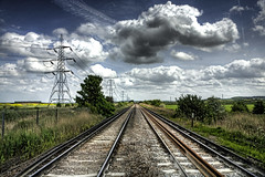Day 53 Gravesend to Higham (Gregory Warran) Tags: nature lines sunshine clouds train canal kent track crossing infinity perspective creative tracks railway illegal reality leading hdr highdynamicrange realism rapeseed gravesend unlawful photomatix project365 tonemapped higham 3exposures gregorywarran shortsharpshot gregwarran talkinginwhispers seeinginpictures doginacloud