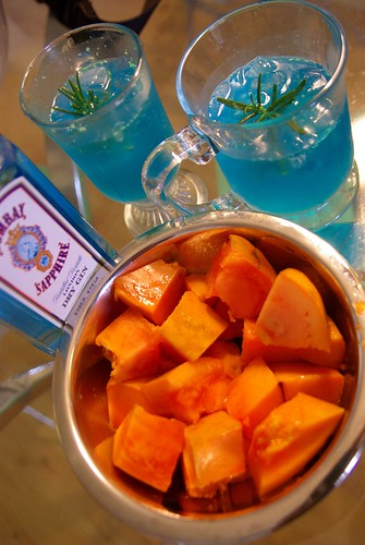 Blue curaçao & rosemary drink + ripe papaya