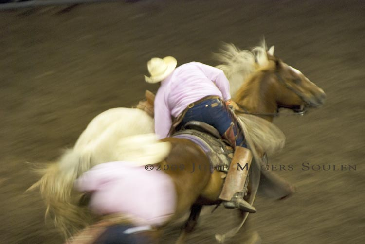 cowboy catches riderless horse at rodeo
