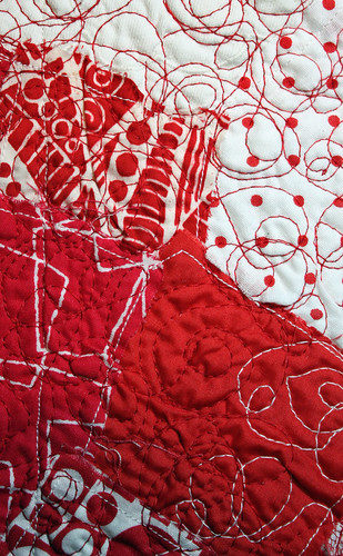 Red and white free motion quilting