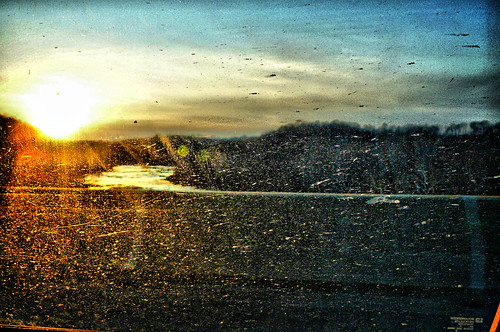 sunset over a river through a dirty window at 70mph