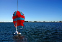Red in the blue (Tati@) Tags: nature water wind australia perth sail fremantle 2009 westernaustralia tati swanriver fineartphotos platinumphoto multimegashot annatatti
