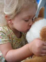 Kissing her bunny.