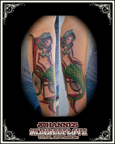 mermaid tattoos. old school mermaid in