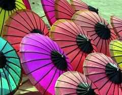 Umbrellas (Alan1954) Tags: holiday asia market quality laos umbrellas 2009 luangprabang blueribbonwinner otw topshots kartpostal mywinner flickrhappy holidaysvacanzeurlaub citrit platinumheartaward theperfectphotographer goldstaraward earthasia goldsealof ilovemypics oltusfotos panoramafotografica