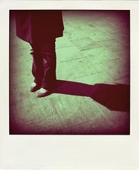 She & herself (Occhidaorientale [Mi votai all'inquietudine]) Tags: barcelona canon polaroid reflex ombra jeans barceloneta luisa piedi spagna scarpe pavimento ballerine polaroidizzamenti thankstoalesstar