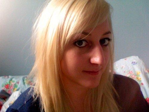 blonde and black hair underneath. londe hair dyed lack. londe