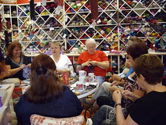 Knitters around the table, catching up on the last week of news and activities