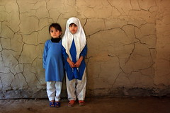 Cousins (Kutan - Kashmir, Pakistan) (Amir Mukhtar Mughal | www.amirmukhtar.com) Tags: blue school pakistan people cute texture wall canon children education uniform dress hijab study angels amir learning kashmir cracks mughal kutan mughals schoolwall amirmukhtar kamicalander