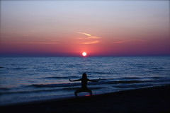 sunset sea music woman sun color roma reflection love beach silhouette canon relax landscape eos donna sand italia tramonto mare waves colours song shades meditation sole colori riflessi taichi spiaggia controluce noa onde sabbia chillout fregene equilibrio stabilimento singita eyeinthesky meditazione sfumature tearsandrain 450d 1855is