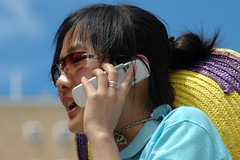 Did you hear the news? (XpatScot (away)) Tags: sunglasses student call d70 sydney mobilephone sombrero unsw oweek
