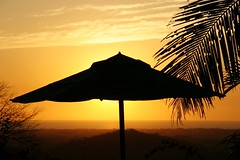 Feel the Warmth (Kathy~) Tags: show sunset orange umbrella triangle costarica warm hero winner tamarindo cw shape fc silohouette bigmomma favescontestwinner pfogold losaltosdeeros herowinner ultraherowinner