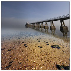 Bembridge Lifeboat Station with wide angle distortion from the Sigma 10mm. (s0ulsurfing) Tags: ocean sea sky seascape seaweed reflection beach nature water lines composition reflections square landscape island mirror coast march pier still interesting skies quiet peace natural patterns jetty wide perspective shoreline wideangle pebbles calm canvas explore reflected coastal filter shore vectis isleofwight solent vista coastline grad landschaft isle 2009 diffused squared wight mellow subtle bembridge 10mm sigma1020 nd4 canvasart s0ulsurfing canvasprints aplusphoto bembridgelifeboatstation eastwight bembridgelifeboat mondocafeclub vosplusbellesphotos bembridgebay gicleecanvasprints