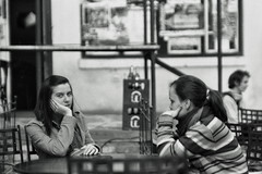 Don't look there but that guy is taking our picture (zedworks) Tags: girls blackandwhite bw white black film home beer analog geotagged iso100 pub 110 romania m42 pan developed ilford praktica foma tgmures jupiter9 mures dring targumures mtl3 ilfordpan100 ilfordpan 10min fomadonlqn f285mm filmdev:recipe=5219 fomafomadonlqn geo:lat=46541801 geo:lon=24554787