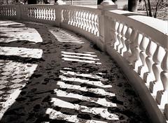 Winter Veranda Curve (Jamie Powell Sheppard) Tags: winter blackandwhite bw snow art 120 film ice architecture mediumformat photo fineart indiana veranda mf railing curve lightandshadow sepiatone mamiya645protl femalephotographer westbadenspringshotel hc110dilb rolleiretro400 autaut 80mmlens