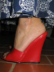 Sara in red wedges (al_garcia) Tags: smelly sandals feet wedge high heels veiny toenails cracked mules shoes red