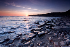 (Claire Hutton) Tags: uk longexposure light sunset sea england sun southwest reflection beach water silhouette clouds bay coast rocks waves stones pebbles cliffs foam dorset sunburst coastline starburst kimmeridge vapourtrails purbecks jurassiccoast isleofpurbeck leefilters 06ndgrad swooshiness 09ndgrad 03ndgrad