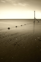 White Pebbles (Andy Brown (mrbuk1)) Tags: longexposure light sea cloud seascape reflection beach water sepia landscape sand underwater stones horizon peaceful calm devon shore serenity marker submerged desolate tones barren deserted tinted tranquil timeless foreground teignmouth luminosity jutting ethemeral neutraldensity groyns leadin