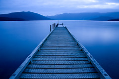 Lake Hauroko, New Zealand. (tomrobinsonphotography) Tags: longexposure blue newzealand lake glass jetty tripod chickenwire hauroko colorphotoaward manfrotto725b lpfloating